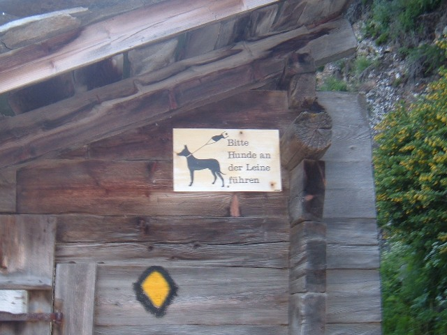 Sign saying 'Please keep your dog on a lead' near Zermatt, Switzerland